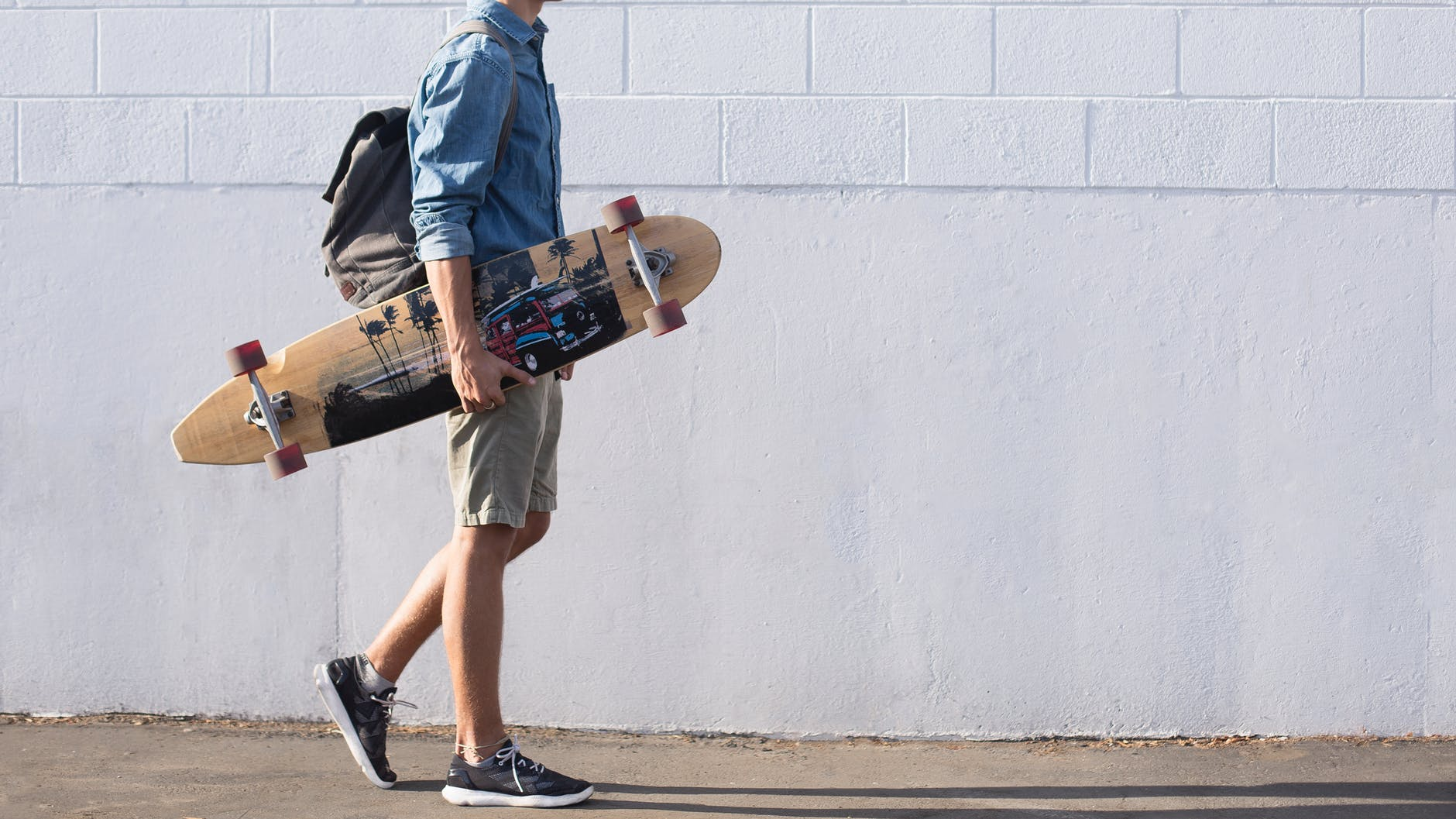 Man walking with skateboard