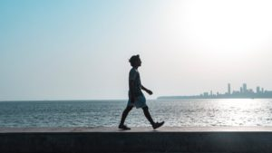 Man walking by water front